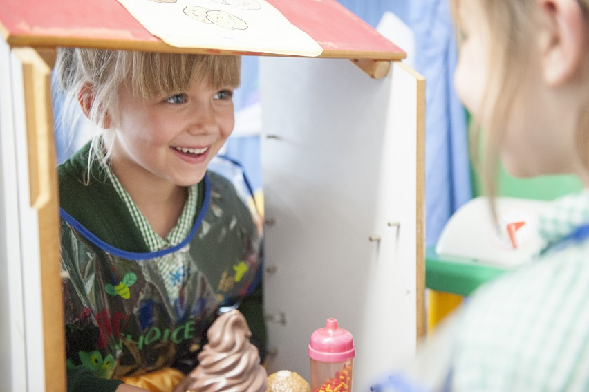 The younger children enjoy role play as part of their curriculum.