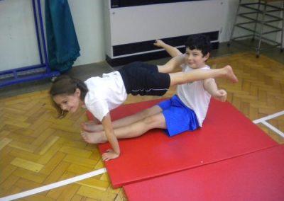Children practising gymnastics.